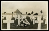 Photograph of an unidentified woman at the grave of Pvt. Frank M. Ring, Co. A, 114th MG Batn., 30th Div.
