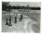 Civilian Conservation Corps workers spreading sand on the beach at the Cumberland Homesteads State Park